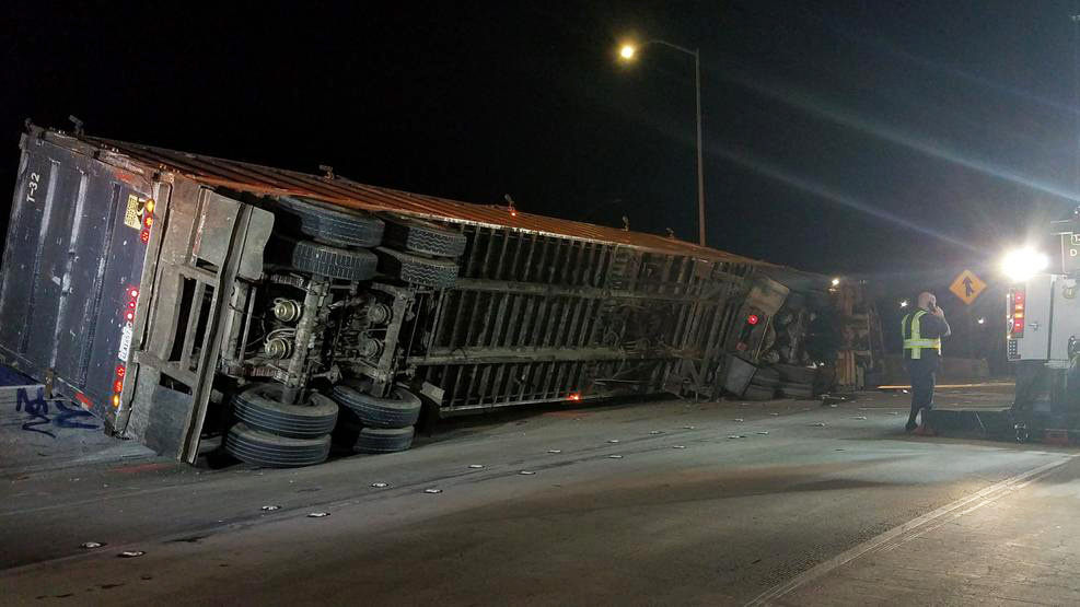 Trash Spills From Overturned Truck on Freeway Transition Near Downtown Los Angeles